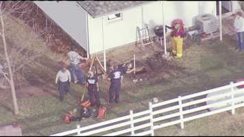 Emergency responders attempt to rescue a non-responsive person from a well in rural Cass County on Thursday evening.