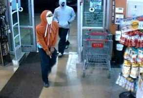 Raytown police say two men attempted to rob the liquor department of a grocery store on Highway 350 Thursday night.