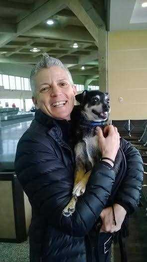 New owner Kel Kelly, of Boston, with Puck after arriving in Kansas City to adopt him.