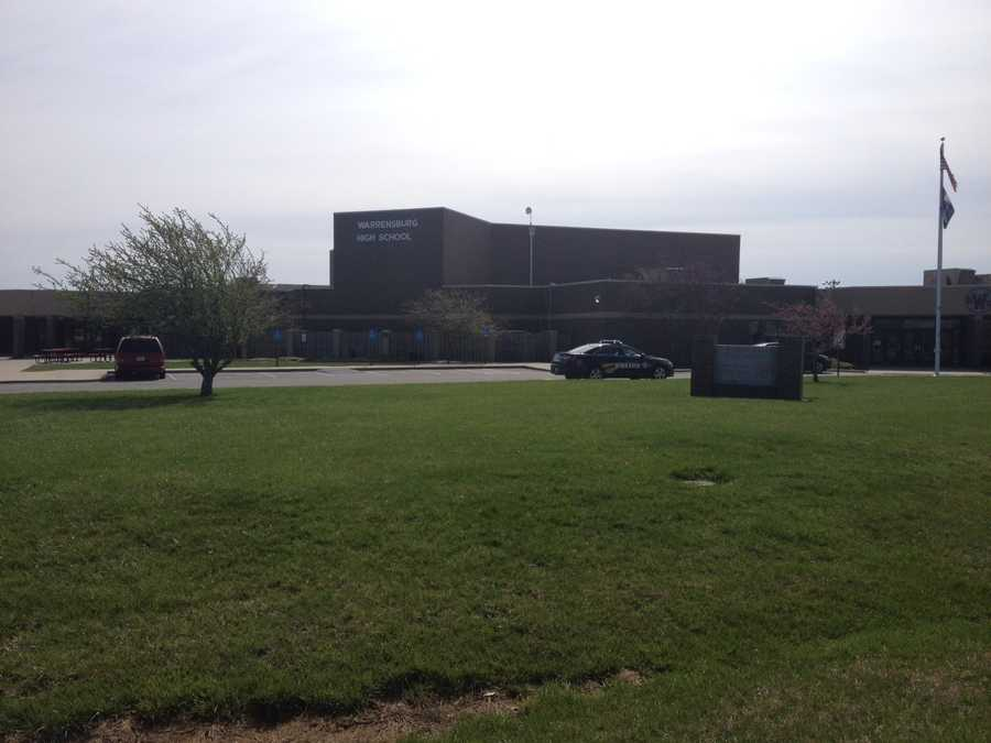 Another view outside Warrensburg High School, where police were on scene after a student was spotted with a gun in the parking lot.