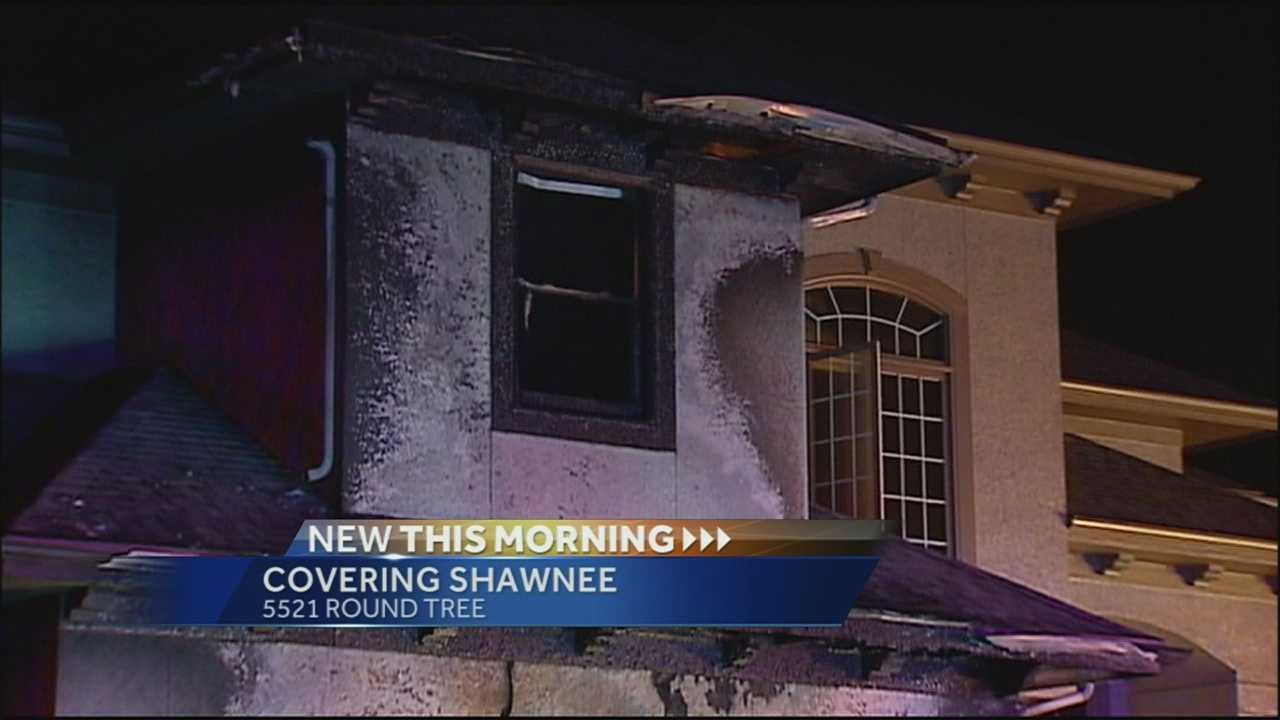 A fire that apparently started in a garage damages a Shawnee, Kan, home overnight.
