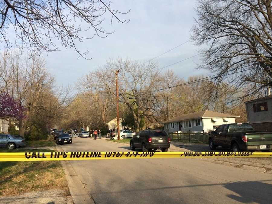 Several blocks in Grandview, Mo., are surrounded by police as a search warrant is executed in connection with the news that a highway shootings suspect is in custody.