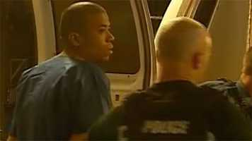 The suspect in the random highway shootings reported in the Kansas City area is brought into police custody downtown.