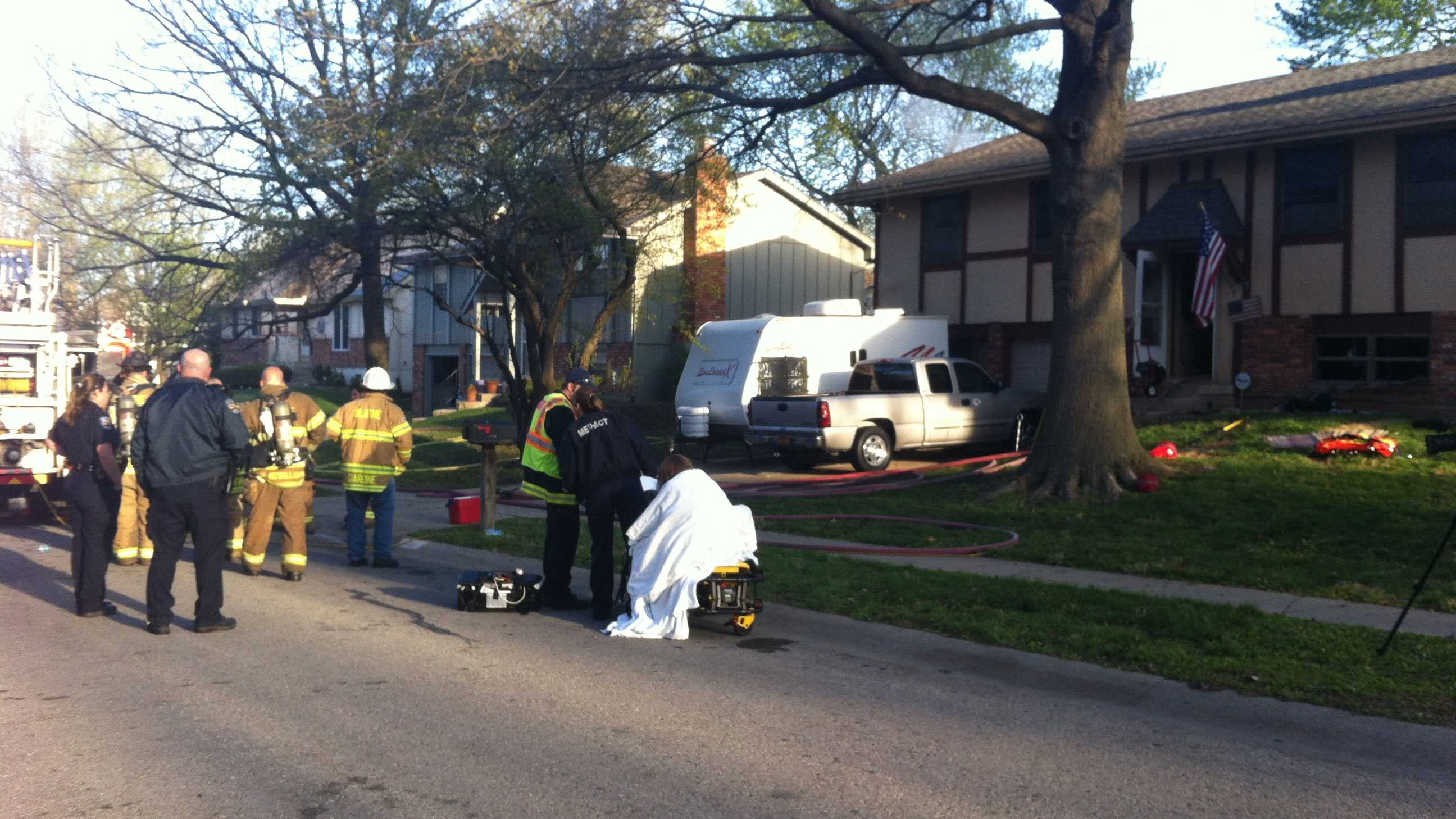 Olathe house fire, woman rescued