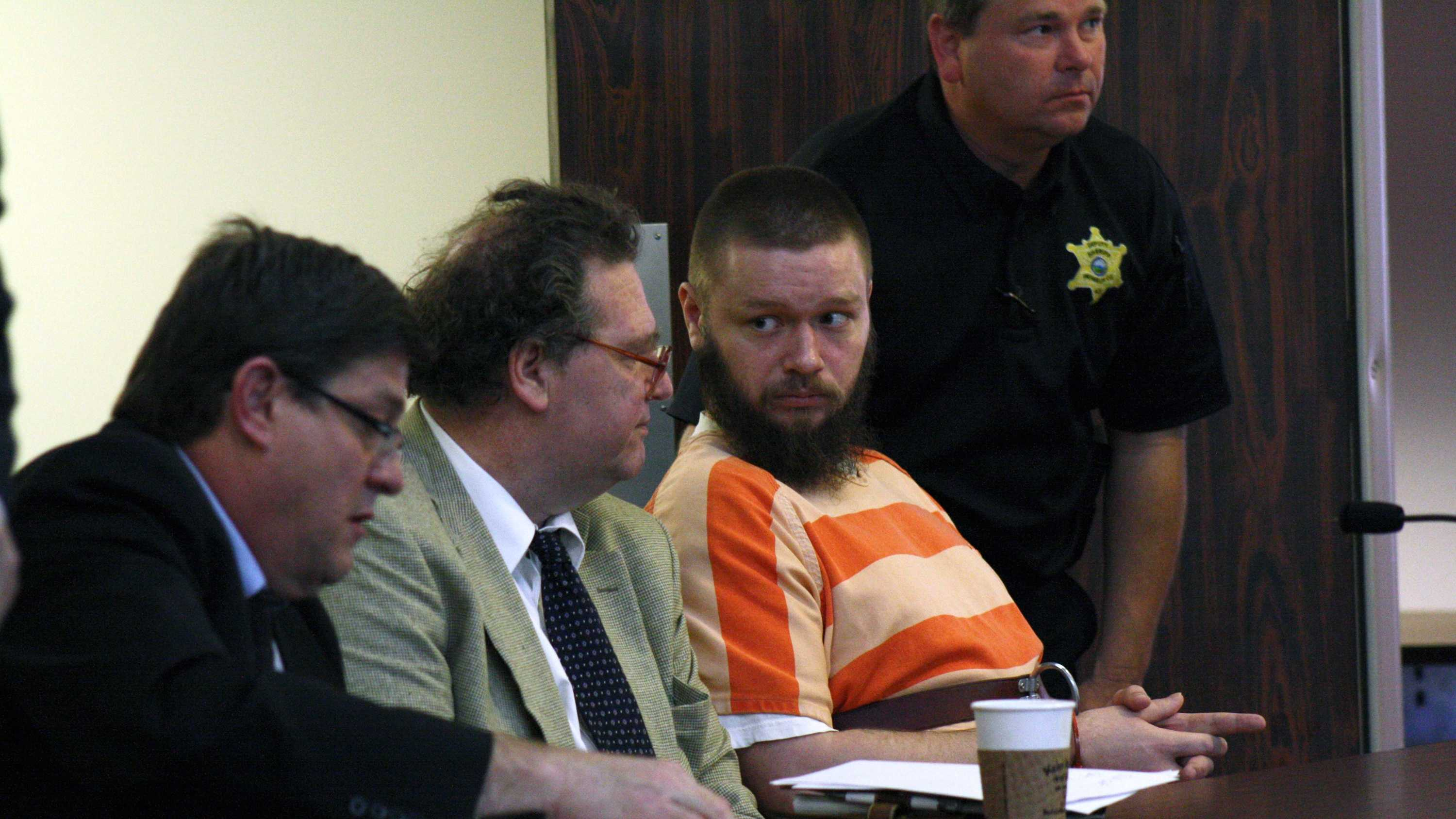 "Kyle Flack, 28, Ottawa, right, sits Tuesday morning with his attorneys, Tim Frieden and Ronald Evans, both of whom work with the Kansas Death Penalty Defense Unit. Prosecutors are seeking the death penalty against Flack, who is charged in a spring 2013 quadruple homicide at a home west of Ottawa. The death penalty attempt is connected to the capital murder charge Flack faces in the killings of Kaylie Bailey and her 18-month-old daughter, Lana Bailey. Flack also faces two charges of first-degree murder, which each carry a ""Hard 50"" sentence if convicted, in the killings of Andrew Stout and Steven White, as well as one count of criminal possession of a firearm. (Photo by Clinton Dick/The Ottawa Herald)"