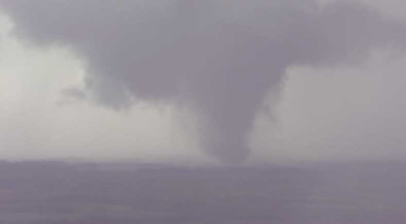 Exclusive images from KMBC's NewsChopper 9 HD of a tornado on the ground in southeast Kansas on Sunday evening.