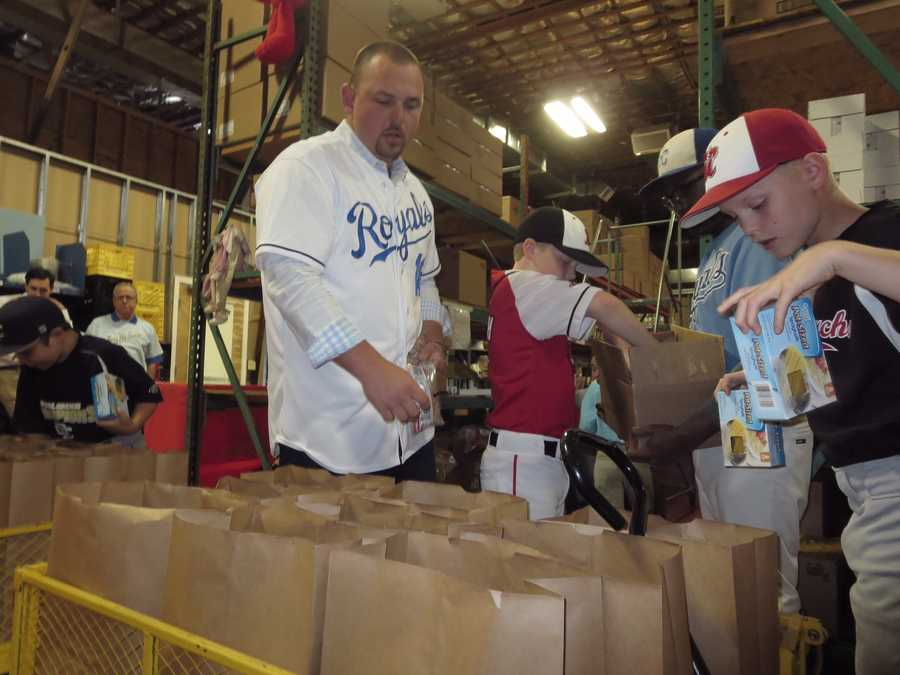 To kick off the initiative, Butler will join several youth baseball players at 4 p.m. Monday to sack groceries and later serve a meal to hundreds of people at St. James Place.