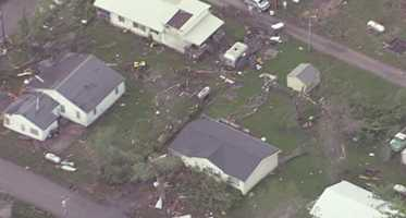 Images from NewsChopper 9 HD of widespread tornado damage in Orrick, Mo.