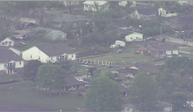A tornado causes extensive damage in Orrick, Mo., Saturday evening.