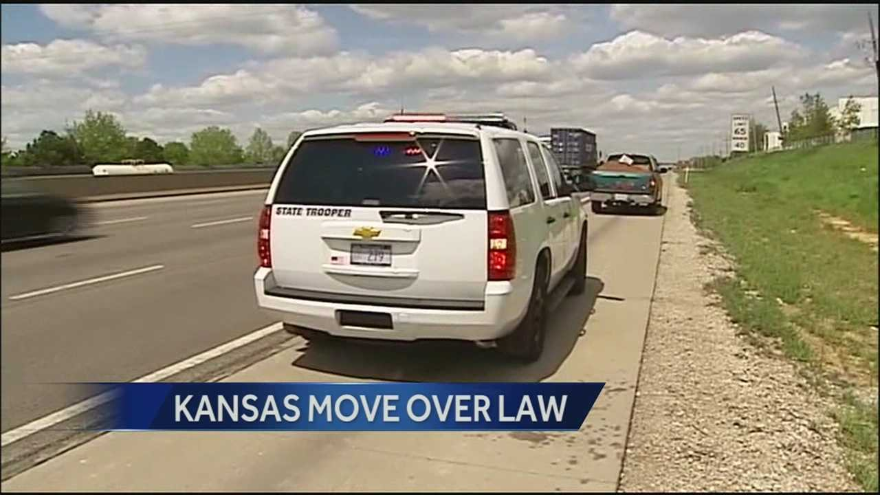 Kansas troopers warn drivers that they will be enforcing the state's move-over law, requiring people to change lanes as they pass an emergency vehicle on the shoulder of the road.