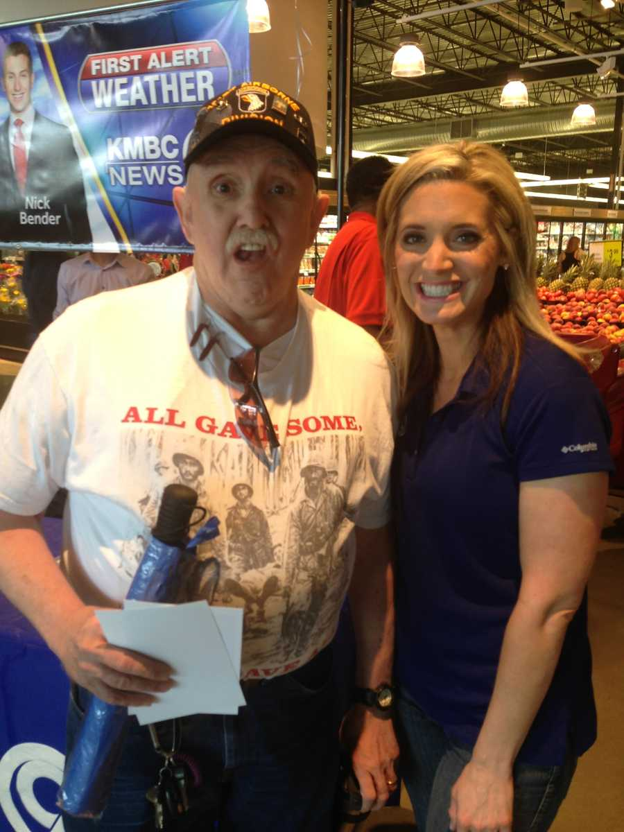 "A local veteran says ""cheese"" as he takes a photo with Erin Little."