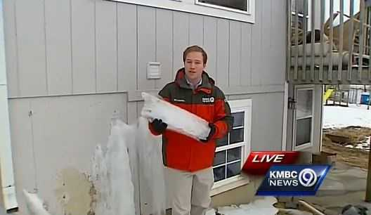 KMBC 9 News Matt Evans shows the chunks of ice that piled up outside of the Parker home.