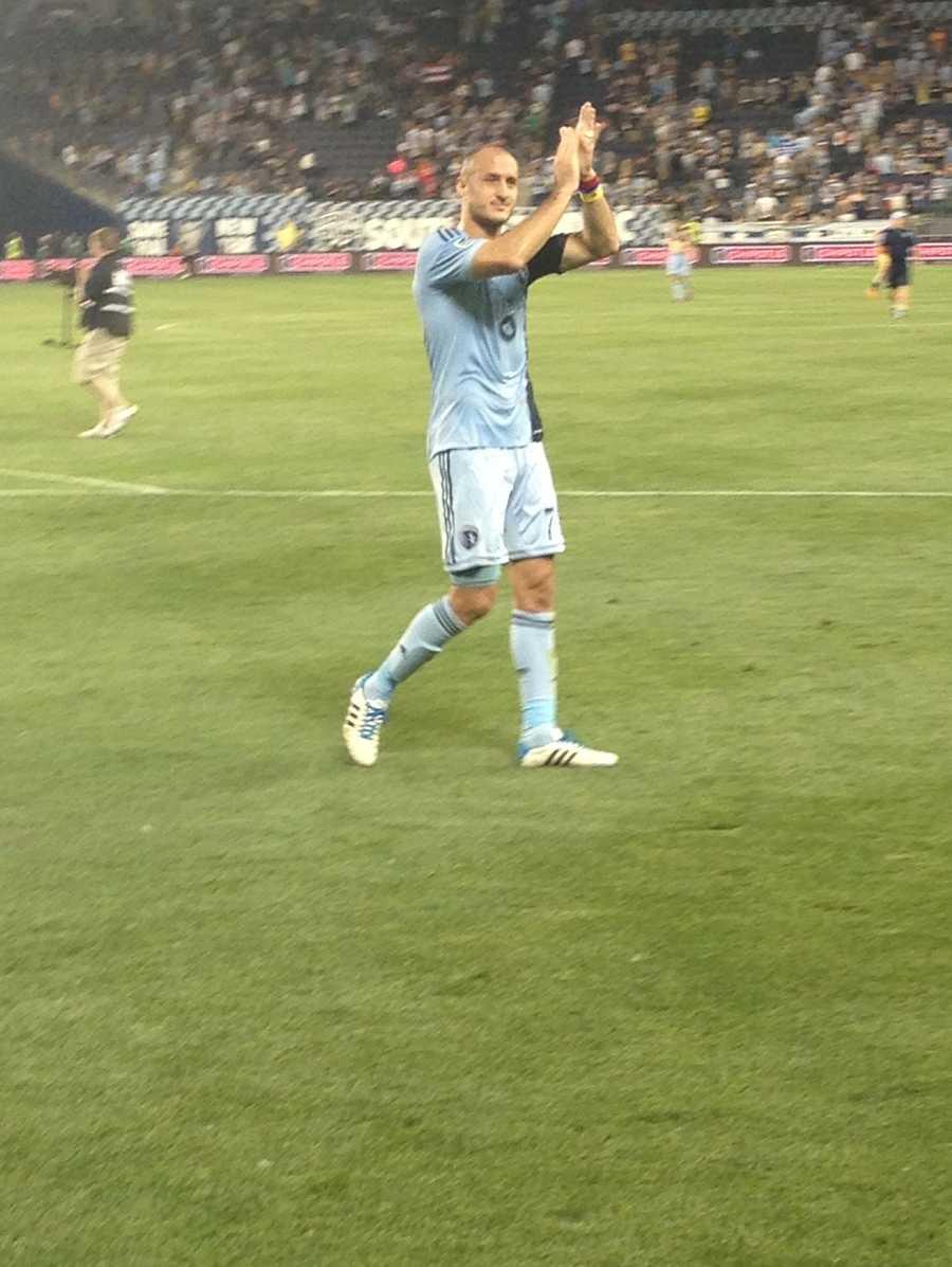 Collin Aurelien applaud fans after a 1-1 tie.