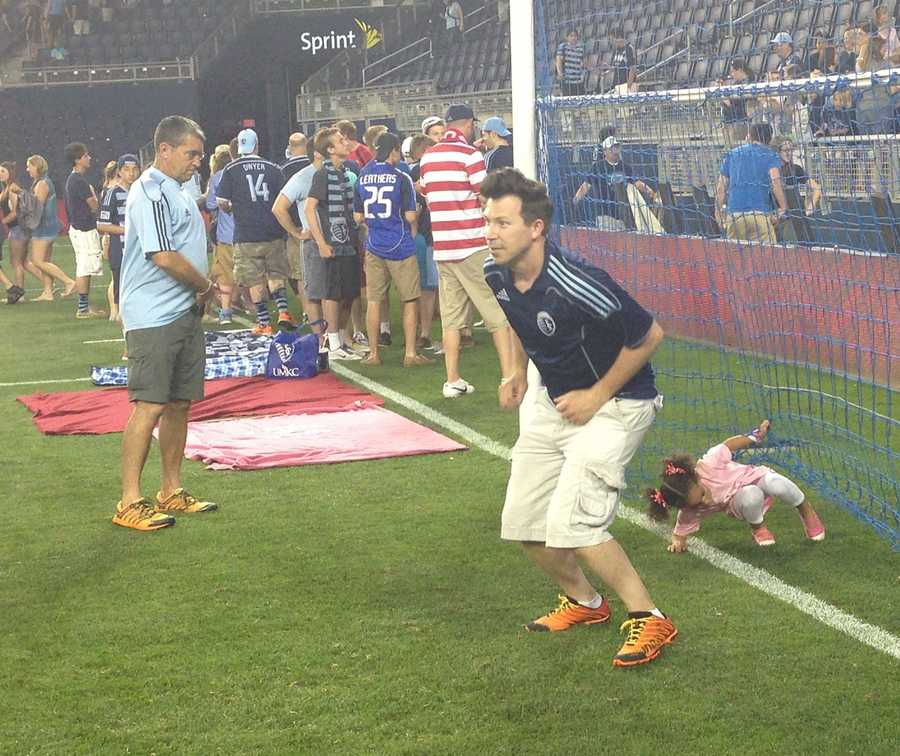 After the Sporting KC game, fans flocked to the field for a picnic-style viewing of a World Cup warmup game on the jumbo-tron.