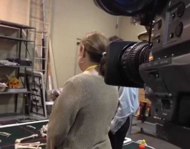 You're looking at a behind-the-scenes of the behind-the-scenes simulation. This is the perspective from veteran cameraman Dick Kasper as he shoots video of Peggy Breit's tour with FBI agents.