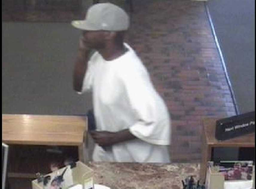 Kansas City FBI office released surveillance pictures of a man suspected of robbing three area banks. In all the robberies, agents said he wore a Kansas City Royals baseball hat.