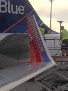 Images from Boston's Logan Airport, where a Southwest Airlines plane bound for Kansas City collided with a JetBlue plane on Monday morning. No injuries were reported, though both planes were damaged.