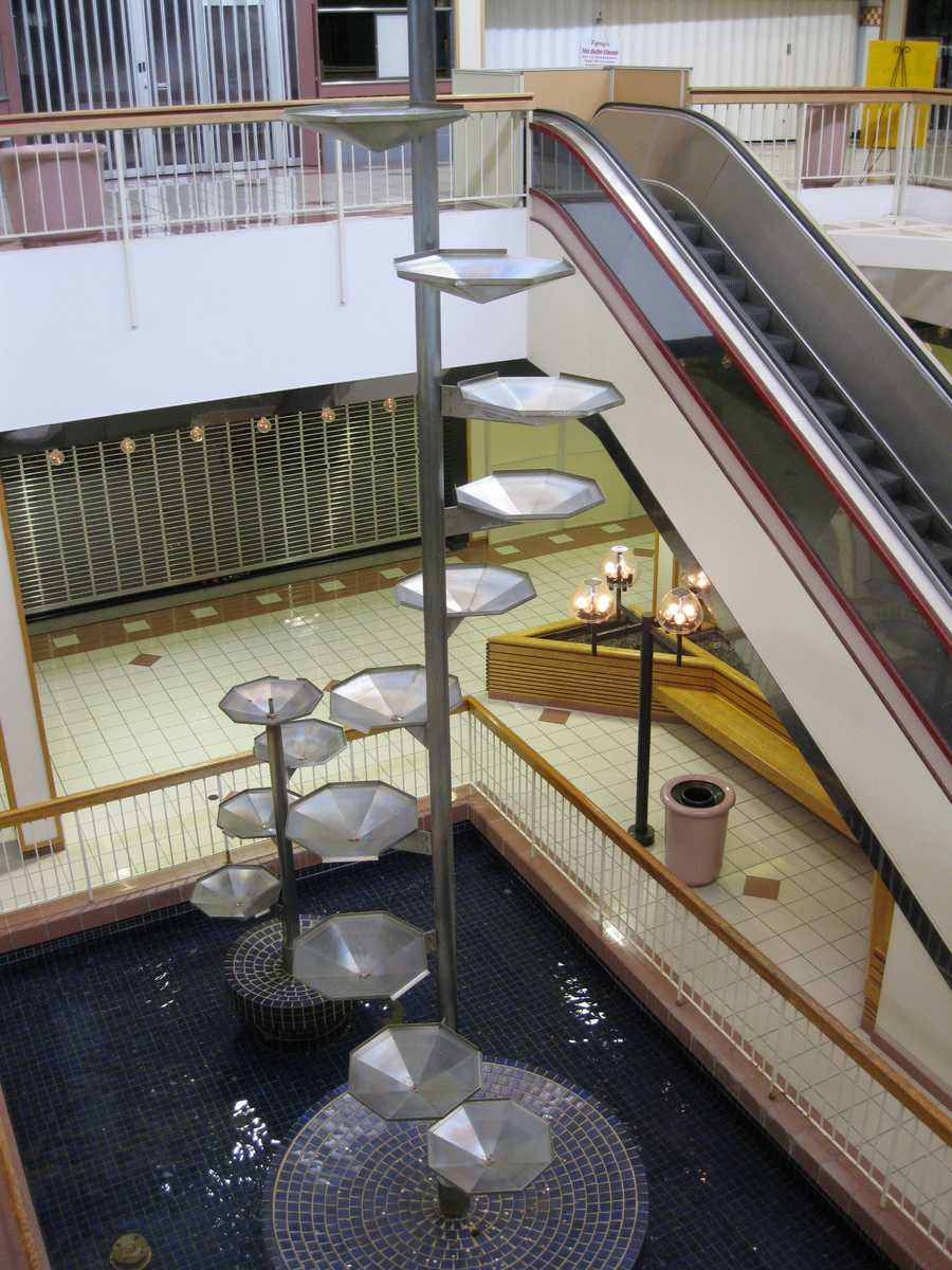Until recently, the popular fountain at the center of the mall had remained running. It was a series of trays on a long pole and water flowed tray-by-tray from the top to the bottom.