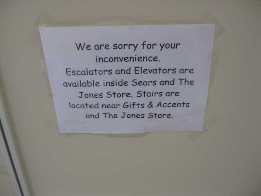 The escalators between the first and second floors have been closed so long that the sign references The Jones Store Company, which has been Macy's since 2006.