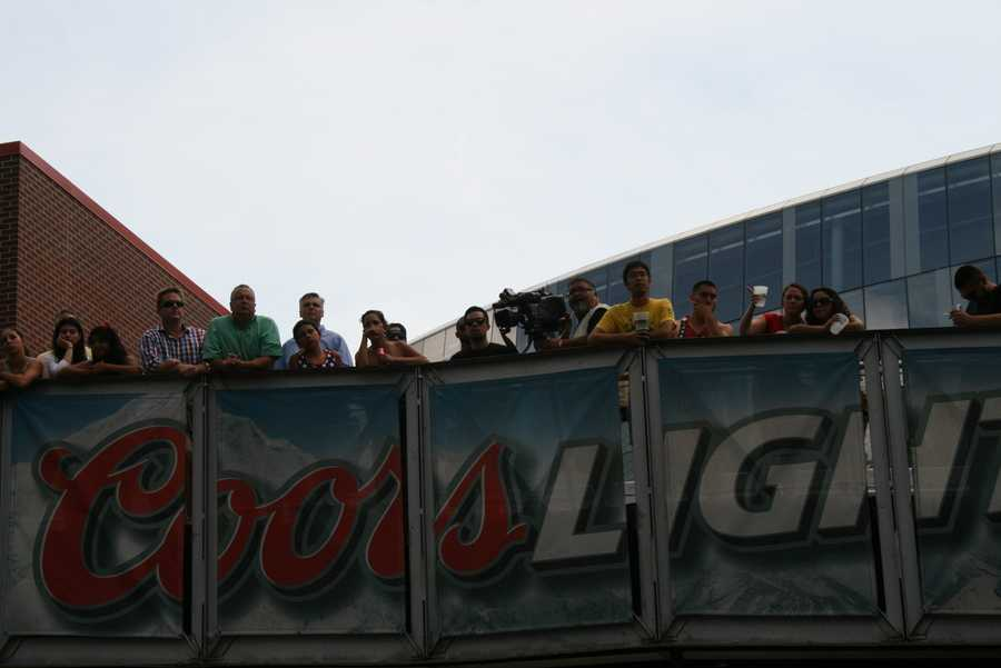 KMBC 9 News photojournalist Laz Abalos overlooking the crowd with his camera. Follow him on Twitter @HeyCameraman
