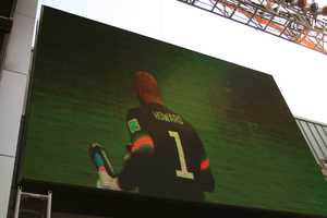 Fans witnessed history on this Jumbotron tv screen.  American goalkeeper Tim Howard recorded sixteen saves, the most-ever by a U.S. goalkeeper.