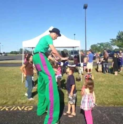 Juggler on stilts entertains the kids.  Legacy Park hosted a variety of activities before a fireworks display on 4th of July eve.