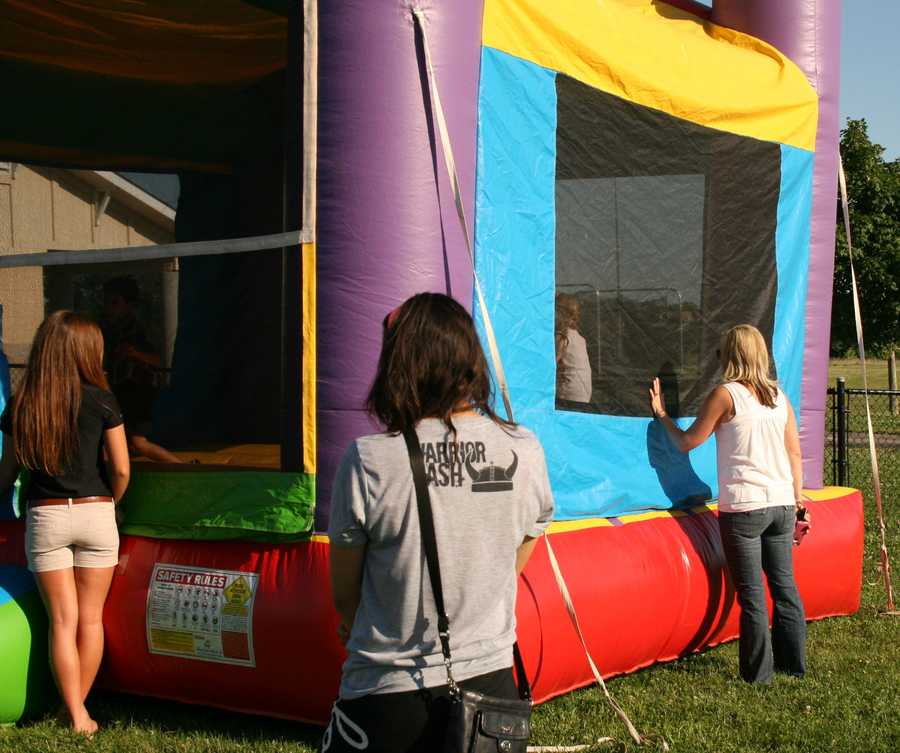 Meteorologist/mother Erin Little watches her girls playing in the bouncy house.
