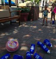 """A new sport we call """"water bottle bowling"""" broke out at Zona Rosa."""