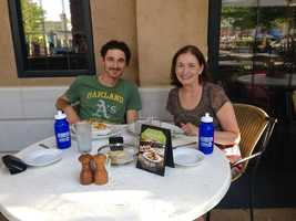 Brian and Noreen enjoy dinner and a water bottle delivery from Bryan Busby.