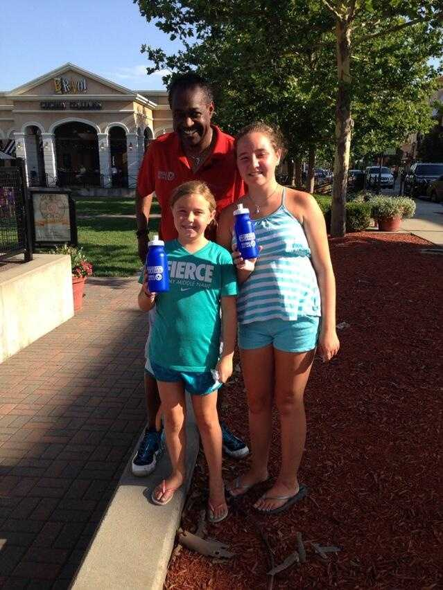 "Chief Meteorologist Bryan Busby handed out water bottles on a very hot night in the Northland.  The ""Hometown Weather"" tour made a stop in Zona Rosa's town square."