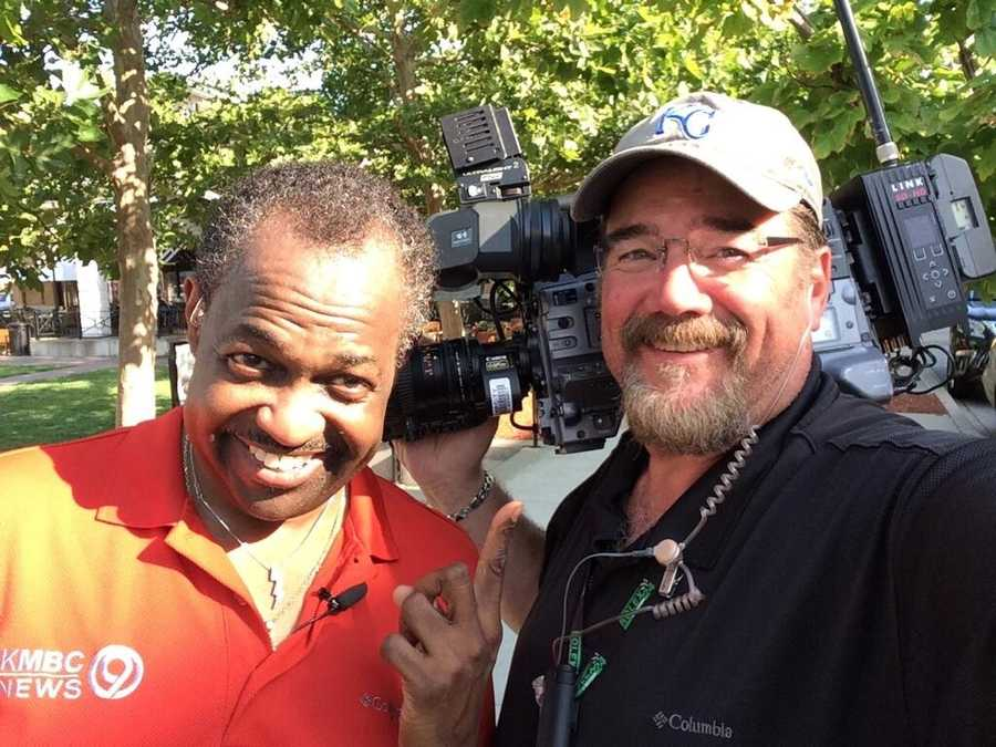 Photojournalist Jeff Field and Bryan Busby pose between live shots.