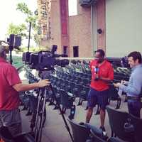 """KMBC 9 News Chief Meteorologist Bryan Busby interviews stage manager Ryan J. Bell at Kansas City's Starlight Theatre. Bell oversees the production of """"Joseph and the Amazing Technicolor Dreamcoat."""" Busby visited as part of KMBC's """"Hometown Weather"""" tour traveling to different locations for live reports throughout July."""