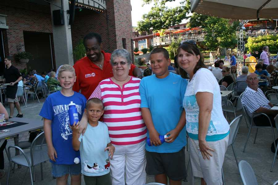 "Bryan Busby hands out some KMBC water bottles and takes pictures with families at Kansas City's Starlight Theatre.  Busby visited as part of KMBC's ""Hometown Weather"" tour traveling to different locations for live reports throughout July."