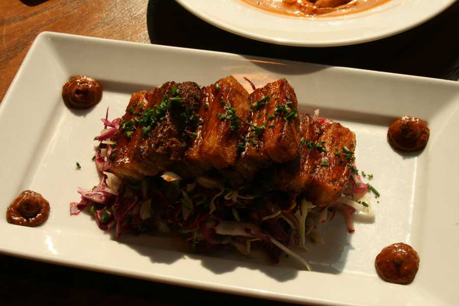 Crisp Pork Belly atop a cabbage slaw with agave-chipotle glaze is served as an appetizer.  Mestizo is just one of many restaurants surrounding the Park Place Leawood concert series.