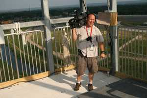Photographer Mark Lea shares a laugh with Nick Bender atop Verruckt.