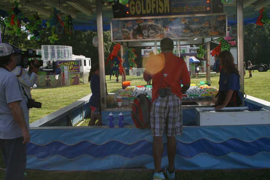 "Bryan Busby tries his hand at goldfish during the Cass County Fair as part of KMBC 9 News' ""Hometown Weather"" series."