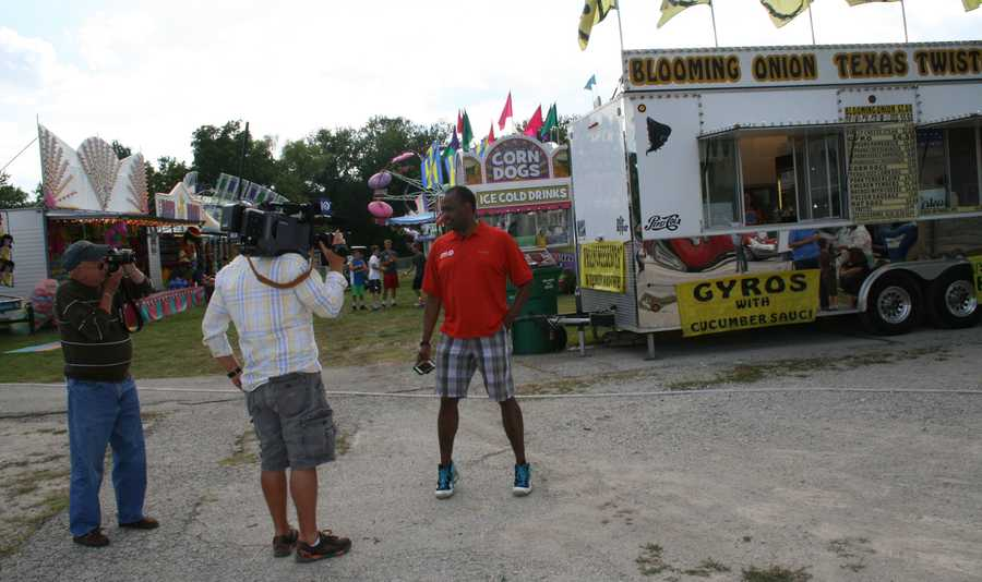 "Bryan Busby dances to ""Gangnam Style"" between live forecasts at the Cass County Fair."