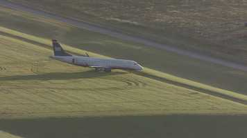 An E170 jet, with USAirways branding, veered off a runway at Kansas City International Airport early Wednesday morning. Only two crew members were on board. They were not hurt. The crew was on a maintenance run at the time.