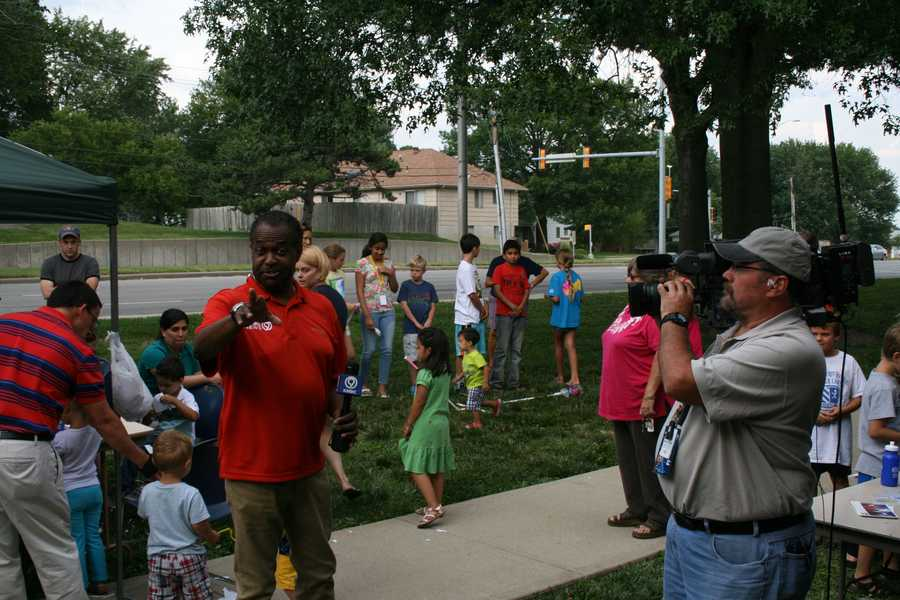 "Bryan Busby tells the photographer ""no more photos"" at the Oak Park Library during KMBC's ""Hometown Weather"" tour."