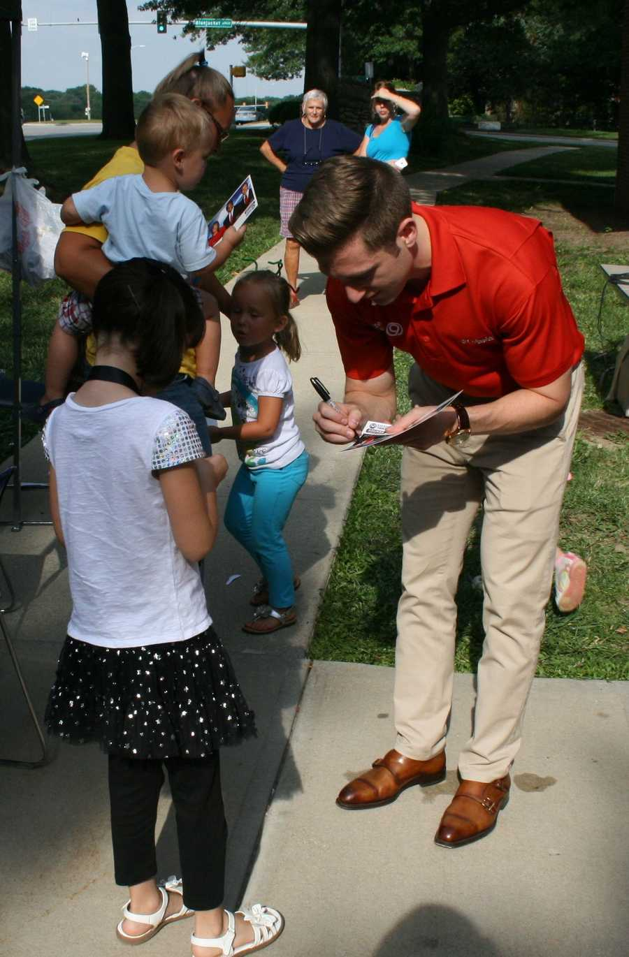 "Nick Bender signs autographs for kids at the Oak Park Library during KMBC's ""Hometown Weather"" tour.  This event is one of many MakerSpace trips organized by the Johnson County Library system."