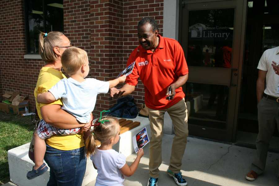 "Chief meteorologist Bryan Busby meets a little boy with a big smile at the Oak Park Library during KMBC's ""Hometown Weather"" tour.  This event is one of many MakerSpace trips organized by the Johnson County Library system."