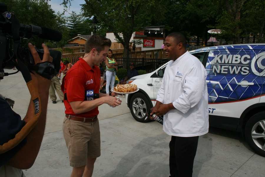 "KMBC's ""Hometown Weather"" tour traveled to Worlds of Fun Thursday.  Executive Chef Kevin Williams made a funnel cake for meteorologist Nick Bender and the KMBC 9 News crew."