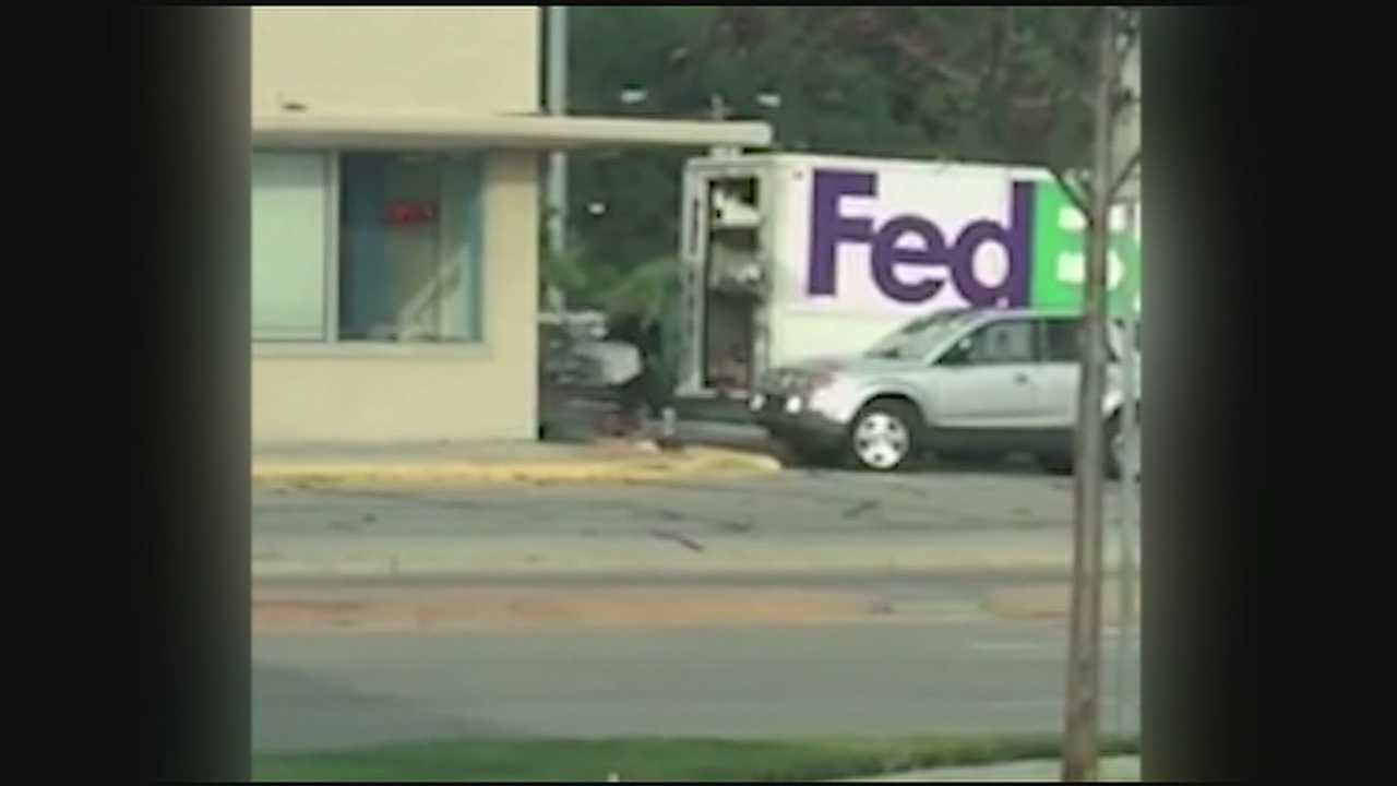 FedEx worker tosses package