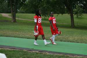 Photos from Chiefs training camp at Missouri Western State University in St. Joseph. Junior Hemingway and Fred Williams walk down to the practice field.