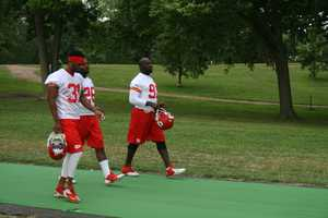 Photos from Chiefs training camp at Missouri Western State University in St. Joseph. Tamba Hali and defensive teammates walk down to the field.