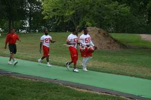 Photos from Chiefs training camp at Missouri Western State University in St. Joseph. Rookie Dee Ford and Derrick Johnson share a laugh on their walk down to the practice field. Click here for more information on Chiefs camp.