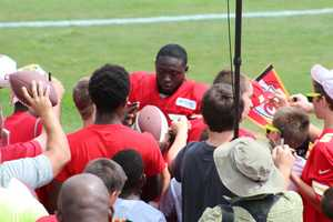 De' Anthony Thomas draws a crowd after practice.