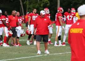 Chiefs Head Coach Andy Reid looks over his notes during wide receiver drills at training camp.
