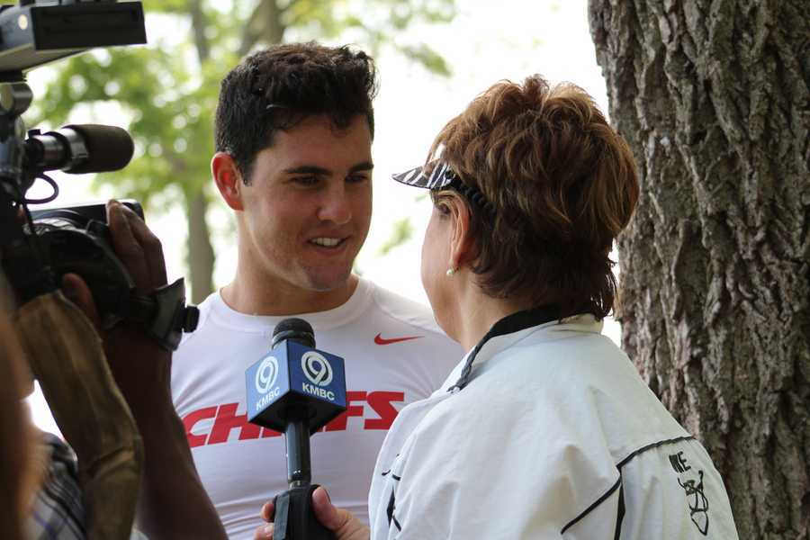 Chiefs rookie quarterback Aaron Murray chats with KMBC 9 News sports reporter Karen Kornacki after practice Wednesday.  Murray was selected by Kansas City in the 5th round of the 2014 NFL Draft (163rd overall).  He played collegiate football at Georgia.