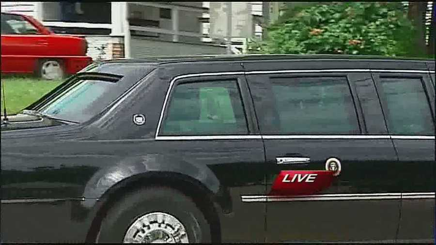 The president waved to a crowd gathered along the street as he left Parkville.